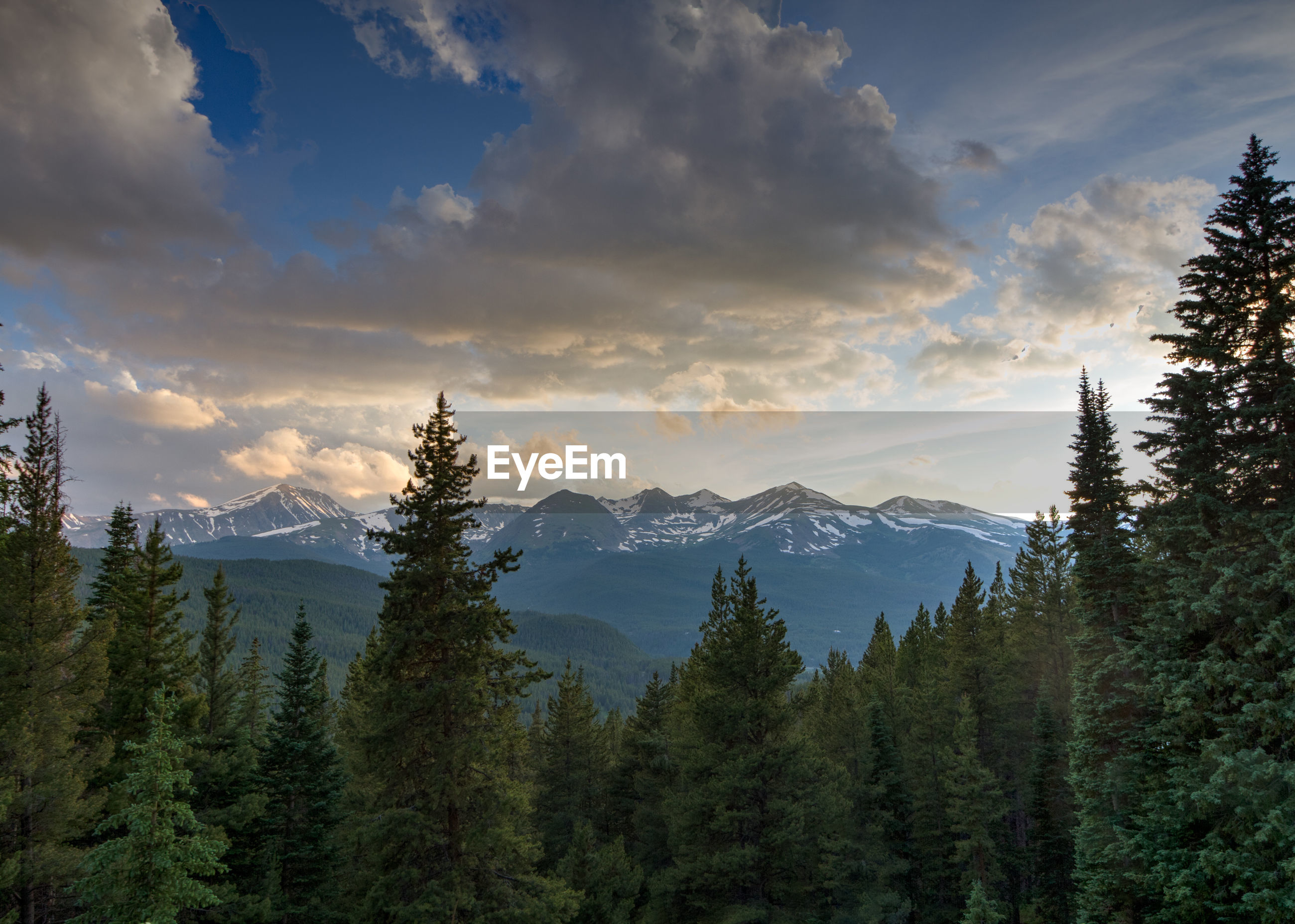 Scenic view of mountains against sky during winter