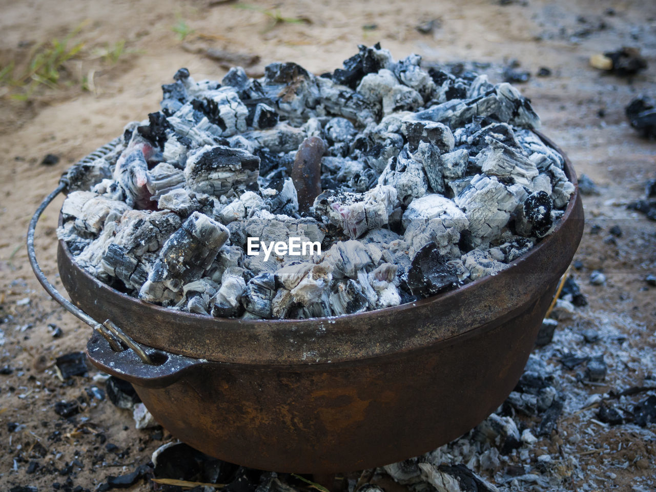 High Angle View Of Cast Iron Pot With Coal