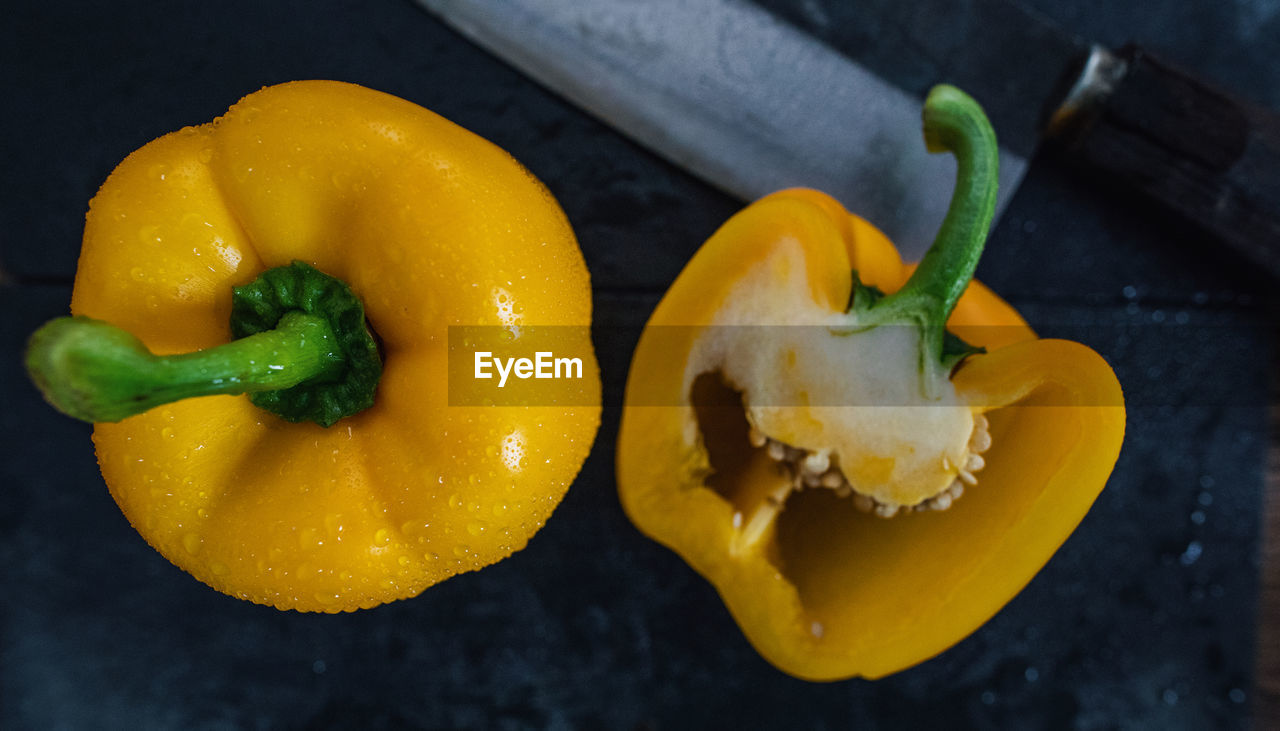 food and drink, food, freshness, yellow, wellbeing, healthy eating, close-up, pepper, no people, vegetable, bell pepper, still life, high angle view, indoors, yellow bell pepper, wet, table, fruit, directly above