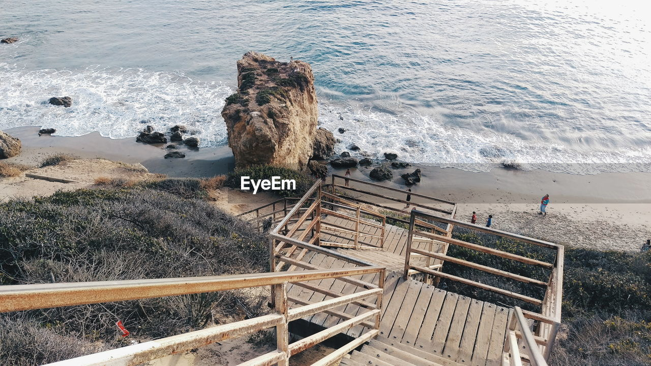 Stairs Leading To Calm Shore