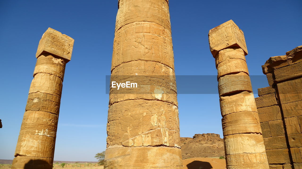 history, the past, ancient, sky, architecture, low angle view, architectural column, ancient civilization, travel destinations, built structure, nature, no people, old ruin, clear sky, day, travel, tourism, sunlight, blue, old, archaeology, outdoors, ruined