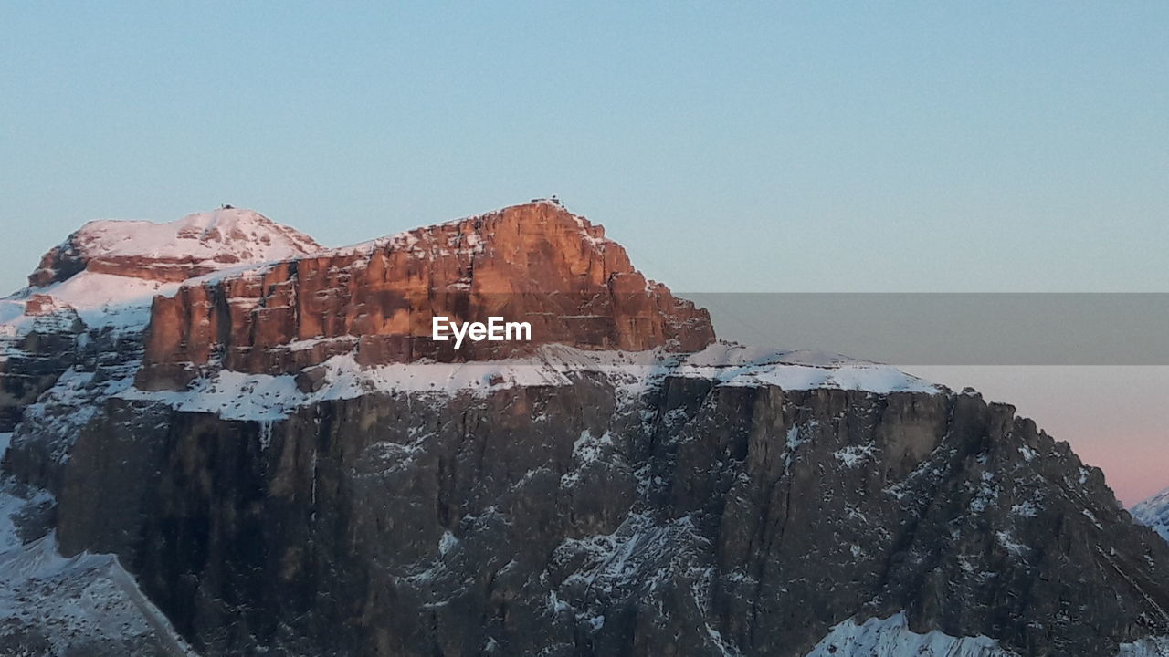 sky, mountain, clear sky, nature, rock formation, beauty in nature, rock, tranquility, scenics - nature, cold temperature, winter, tranquil scene, rock - object, copy space, low angle view, snow, no people, mountain range, solid, mountain peak, formation, outdoors, snowcapped mountain, high