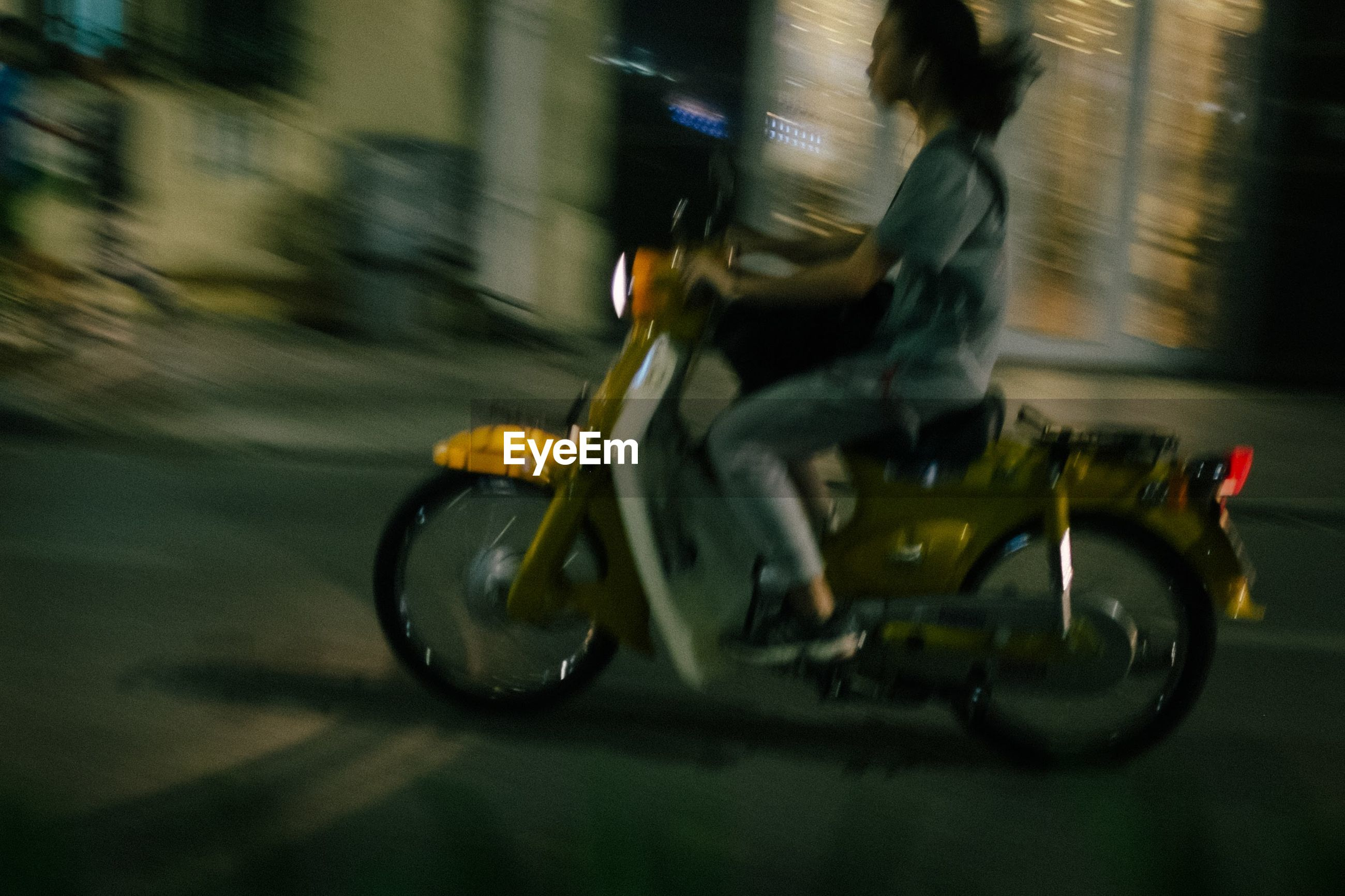 BLURRED MOTION OF MAN RIDING MOTORCYCLE