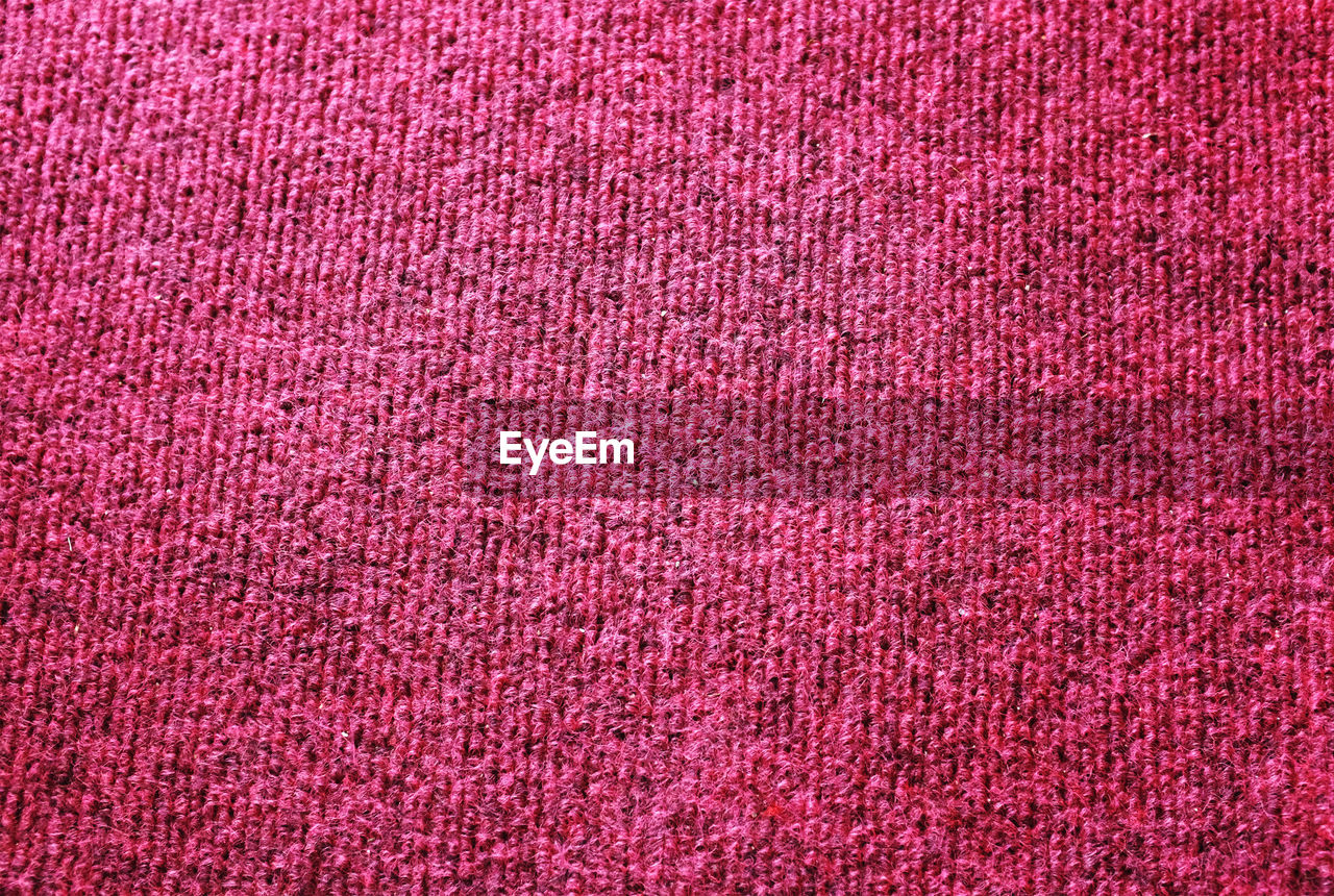 textile, full frame, backgrounds, pink color, wool, textured, pattern, red, no people, close-up, art and craft, indoors, softness, woven, material, directly above, fiber, textile industry, clothing, industry, garment, blank