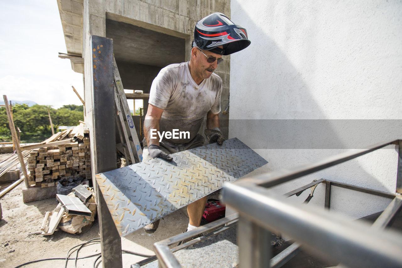 MAN WORKING IN PEN
