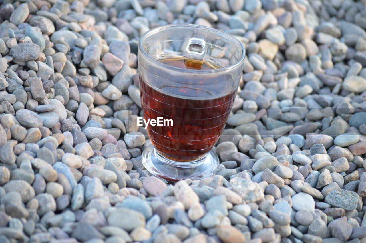 Tea In Cup On Stones At Beach