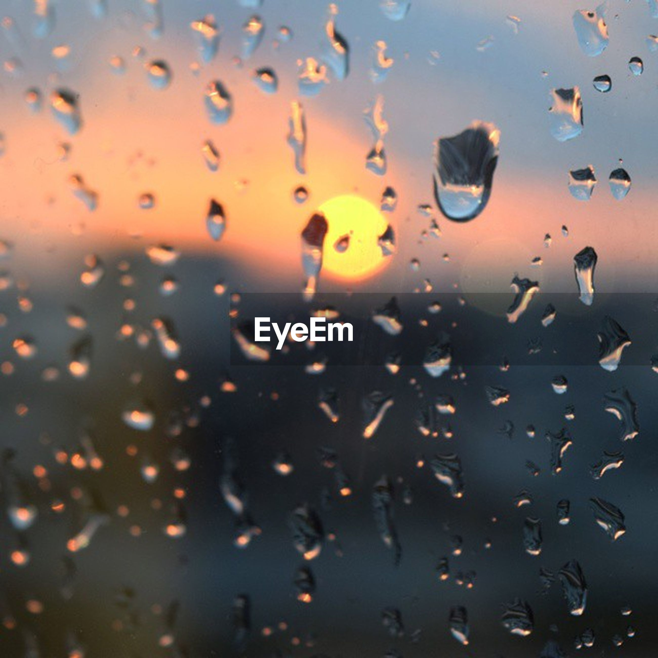 drop, wet, water, transparent, glass - material, window, indoors, full frame, backgrounds, rain, sunset, sky, raindrop, weather, glass, nature, cloud - sky, flying, no people, dusk