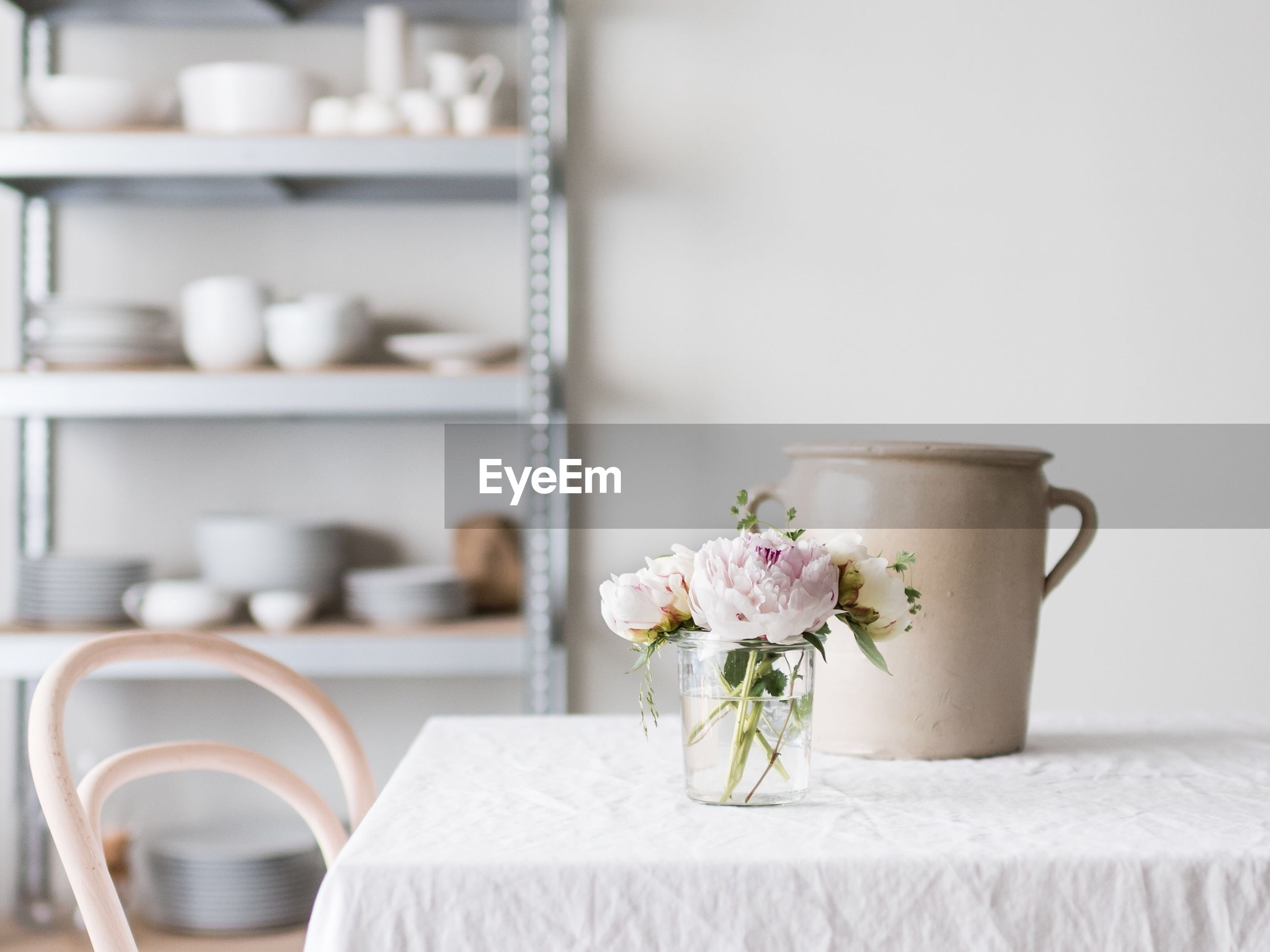 Flowers in container on table