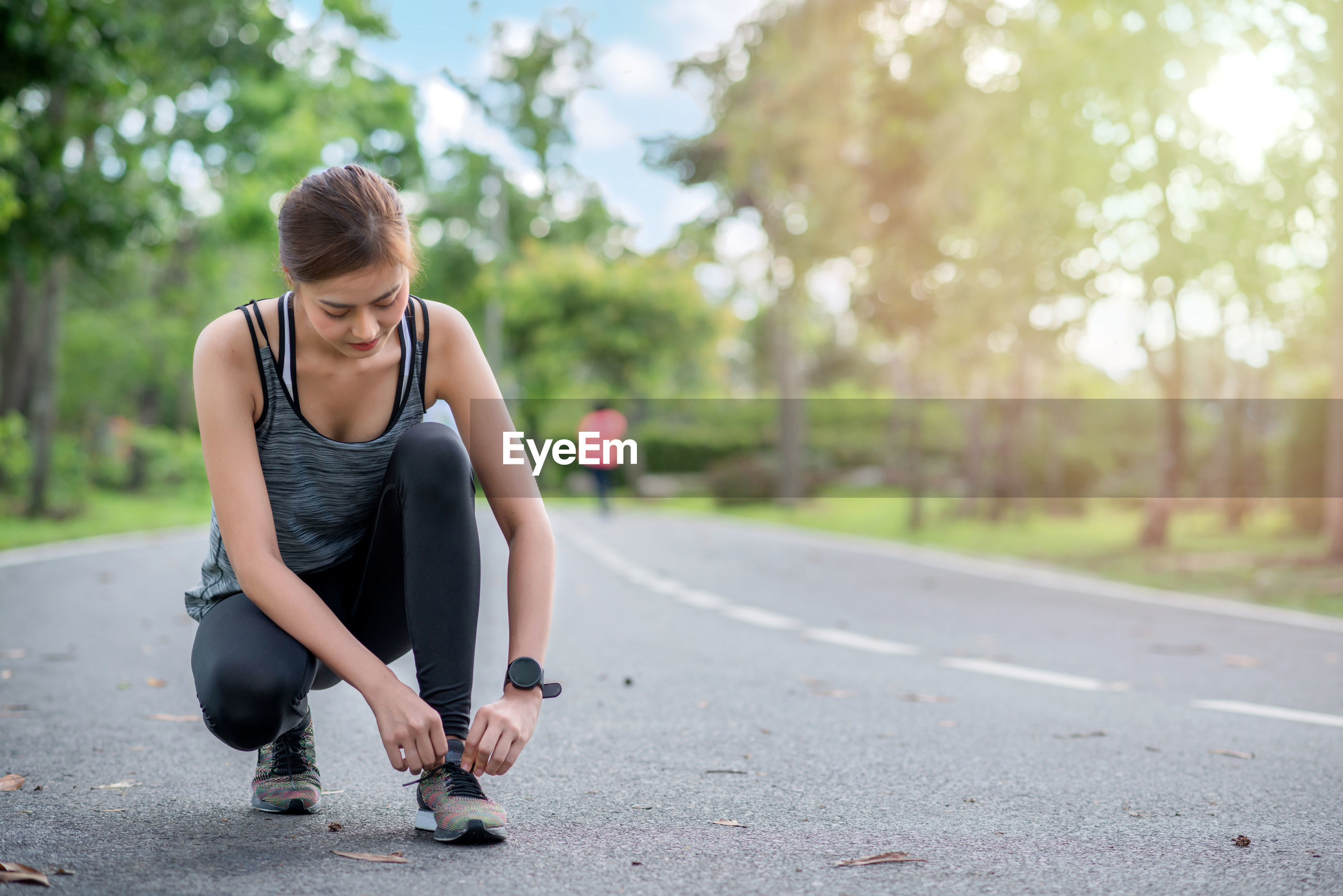 Young asian woman runner doing tying shoelace. she athlete running at garden . sport , healthy