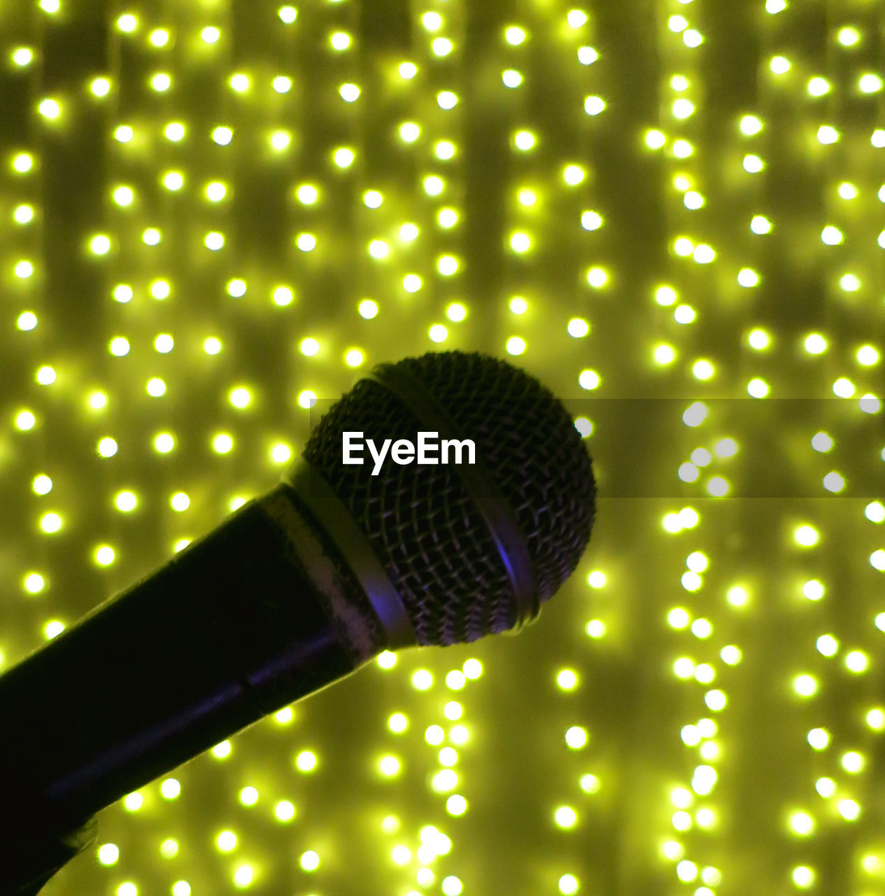 illuminated, lighting equipment, indoors, technology, electricity, glowing, close-up, no people, light, pattern, input device, microphone, light - natural phenomenon, equipment, music, electric light, nightlife, cable, green color, led