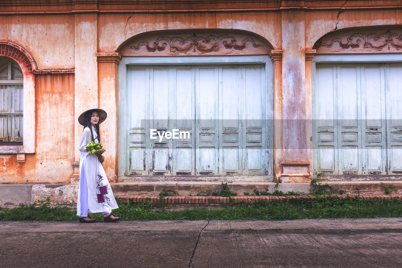 Portrait Of Vietnamese Woman In Traditional Clothing