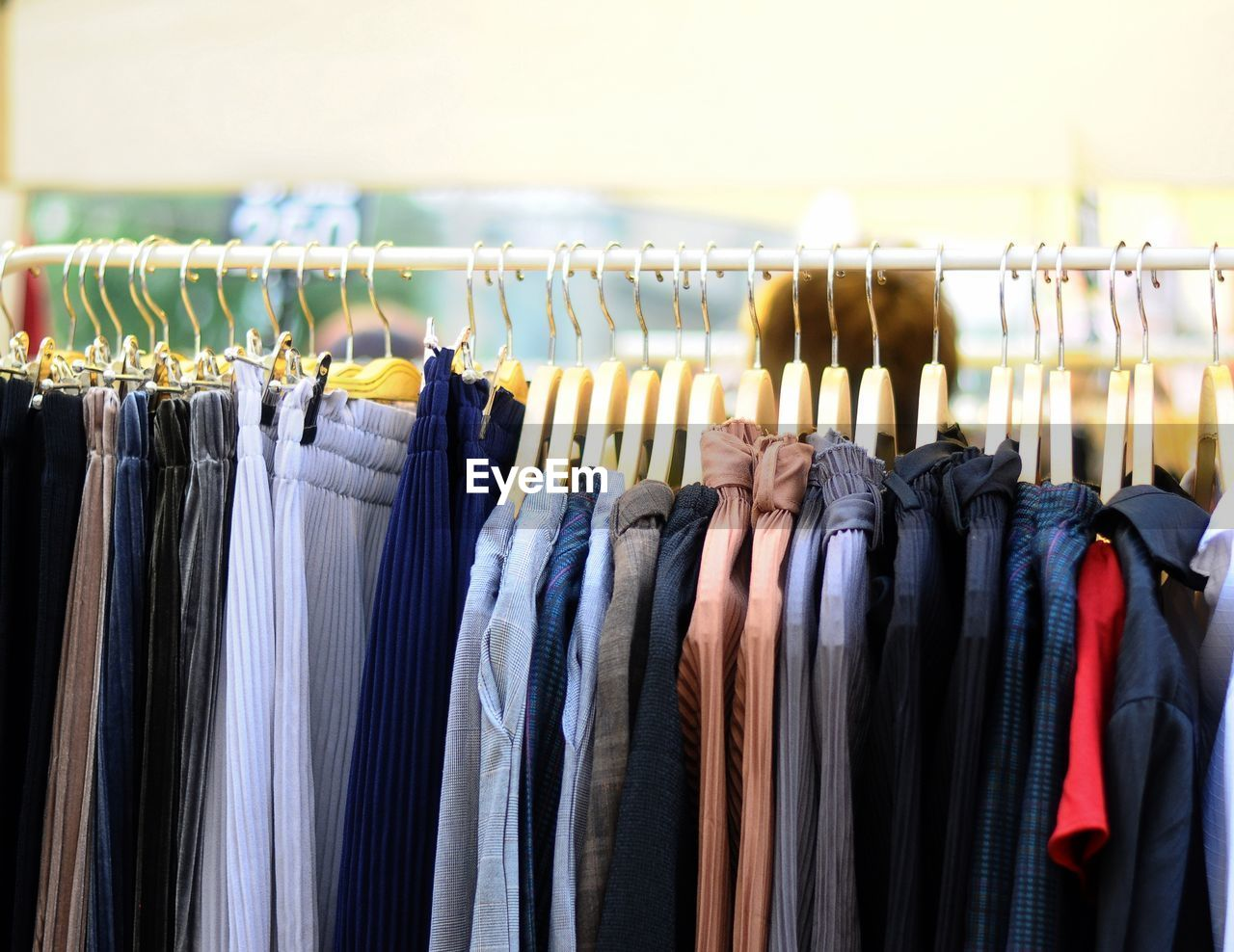 Close-Up Of Clothes Hanging On Rack At Store