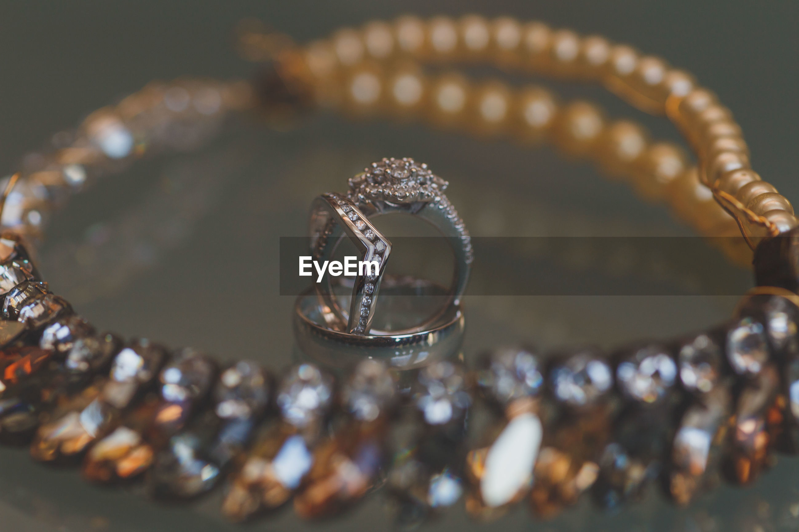 Close-up of jewelries on glass table
