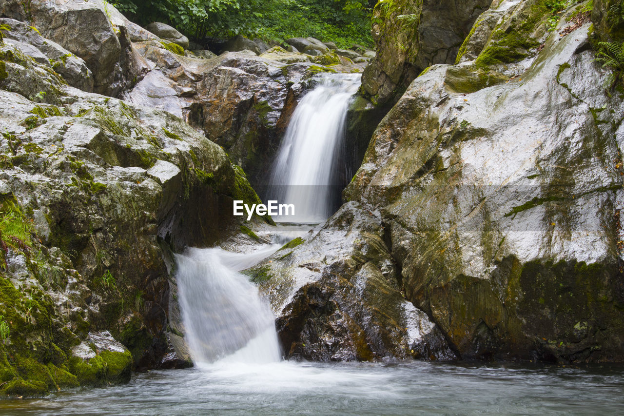scenics - nature, water, waterfall, rock, motion, rock - object, beauty in nature, flowing water, blurred motion, nature, long exposure, solid, environment, rock formation, no people, forest, land, sport, outdoors, flowing, power in nature, stream - flowing water, falling water