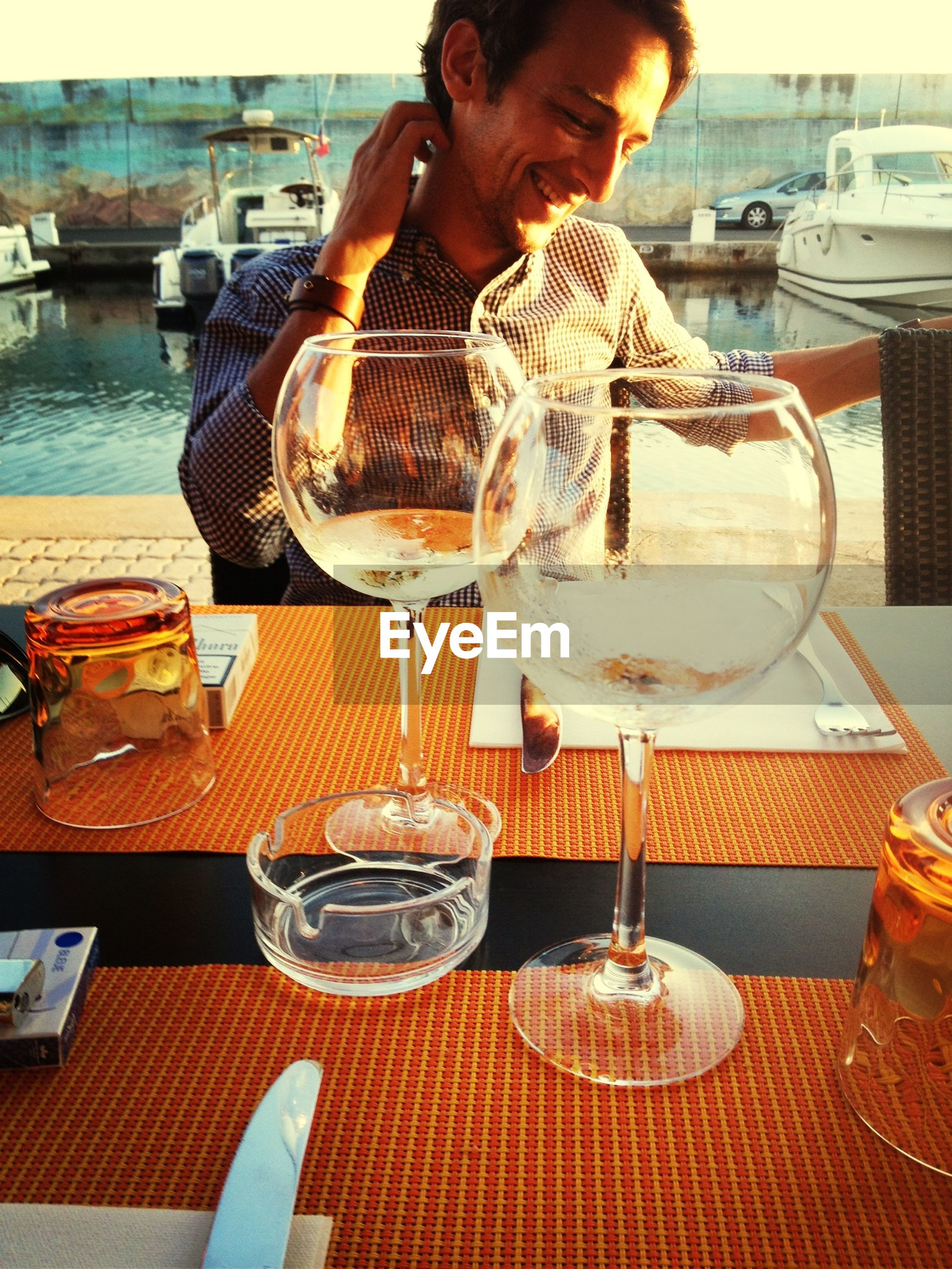 food and drink, table, drink, restaurant, refreshment, freshness, lifestyles, food, drinking glass, leisure activity, wineglass, indoors, sitting, cafe, incidental people, holding, alcohol, indulgence