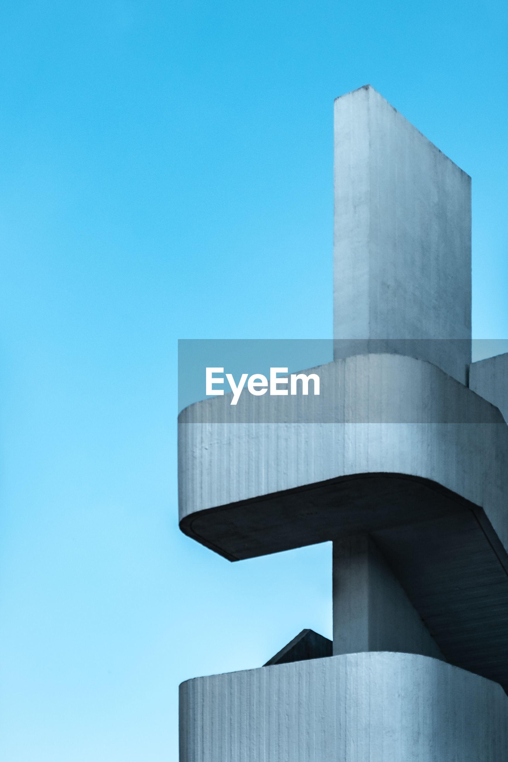 Brutalist staircase against blue sky