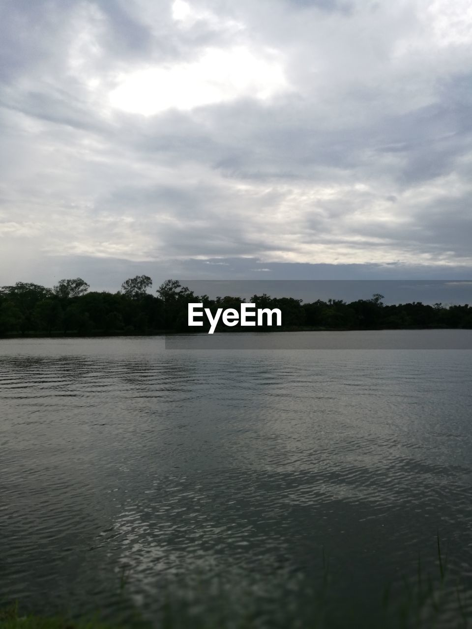 water, sky, tranquility, cloud - sky, nature, lake, tranquil scene, no people, scenics, beauty in nature, tree, outdoors, waterfront, day