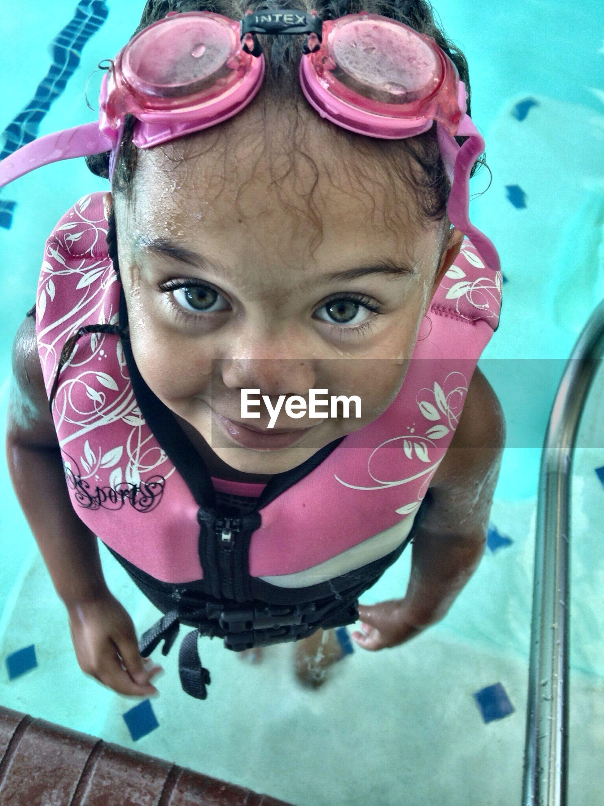 Girl at a swimming pool