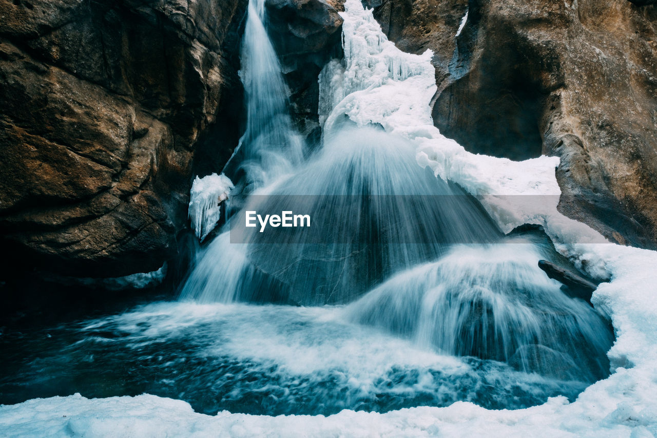 waterfall, beauty in nature, rock, water, scenics - nature, motion, rock - object, solid, long exposure, flowing water, blurred motion, land, nature, no people, day, power in nature, rock formation, flowing, outdoors