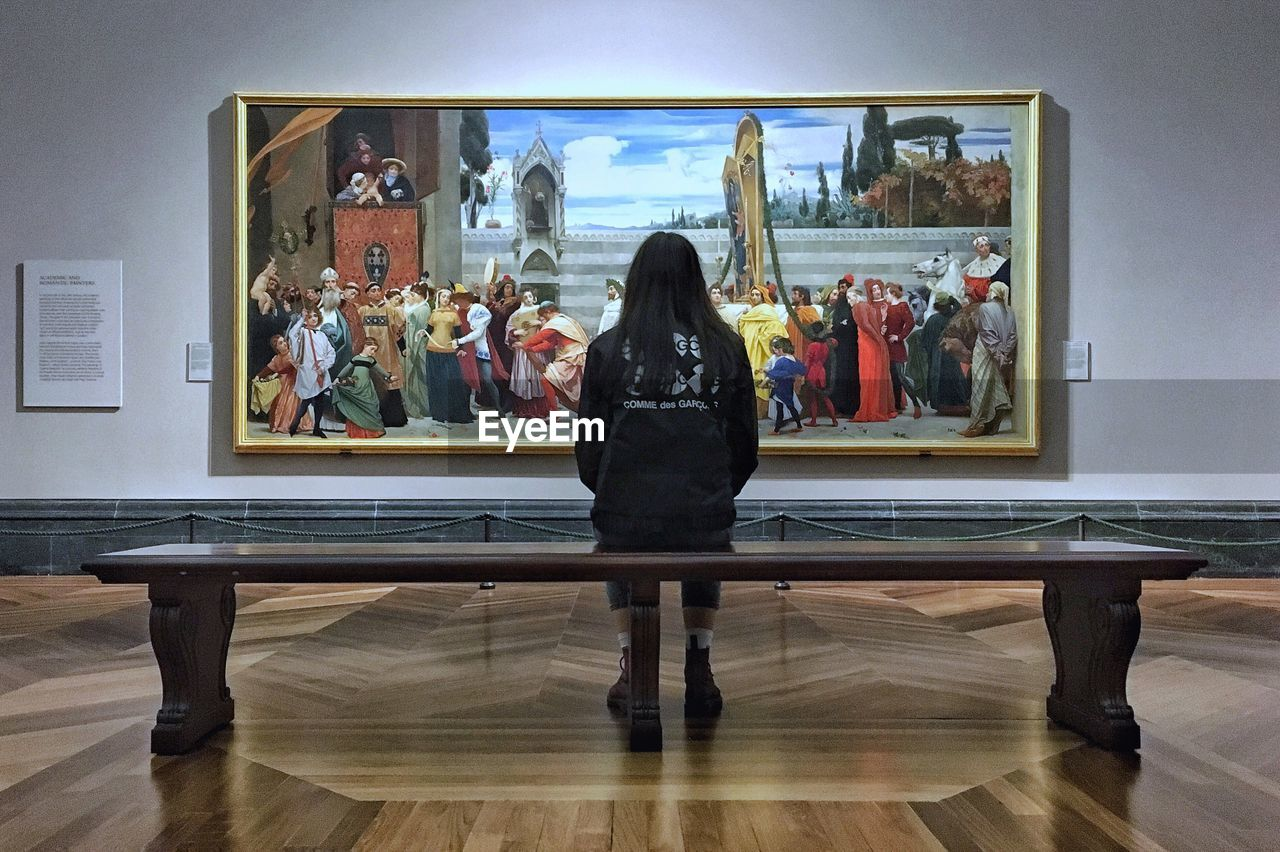 indoors, real people, museum, leisure activity, arts culture and entertainment, full length, women, lifestyles, one person, sitting, day, people