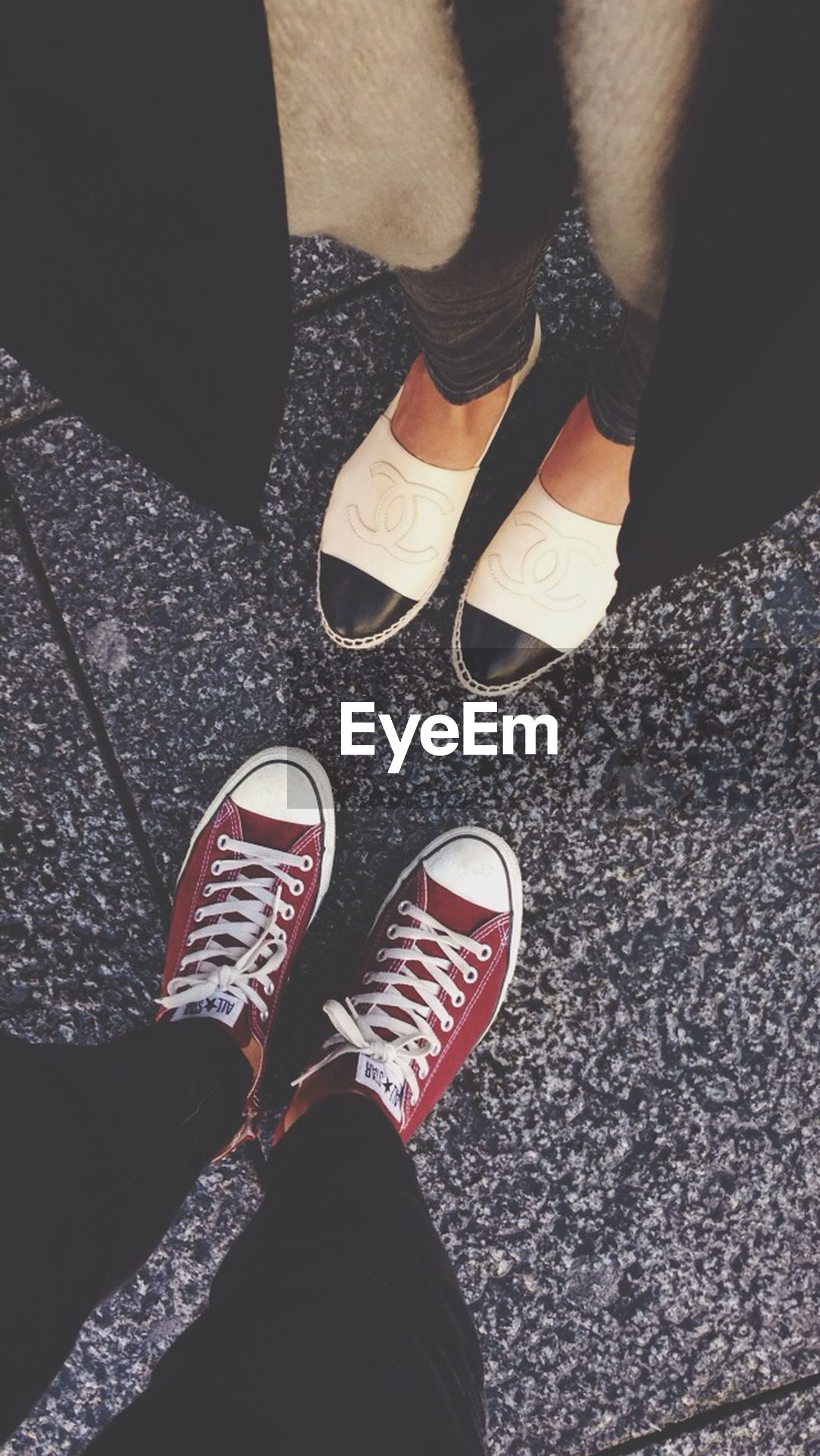 low section, person, shoe, standing, personal perspective, footwear, lifestyles, human foot, high angle view, street, leisure activity, men, unrecognizable person, canvas shoe, road, jeans
