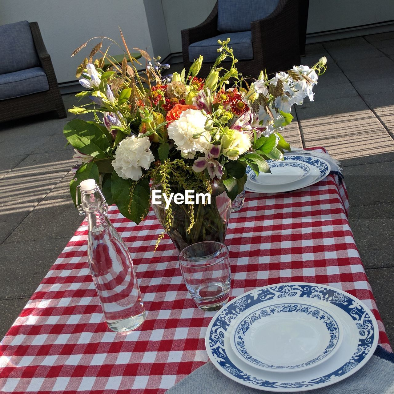 flower, table, vase, high angle view, food and drink, tablecloth, bouquet, freshness, no people, day, plate, indoors