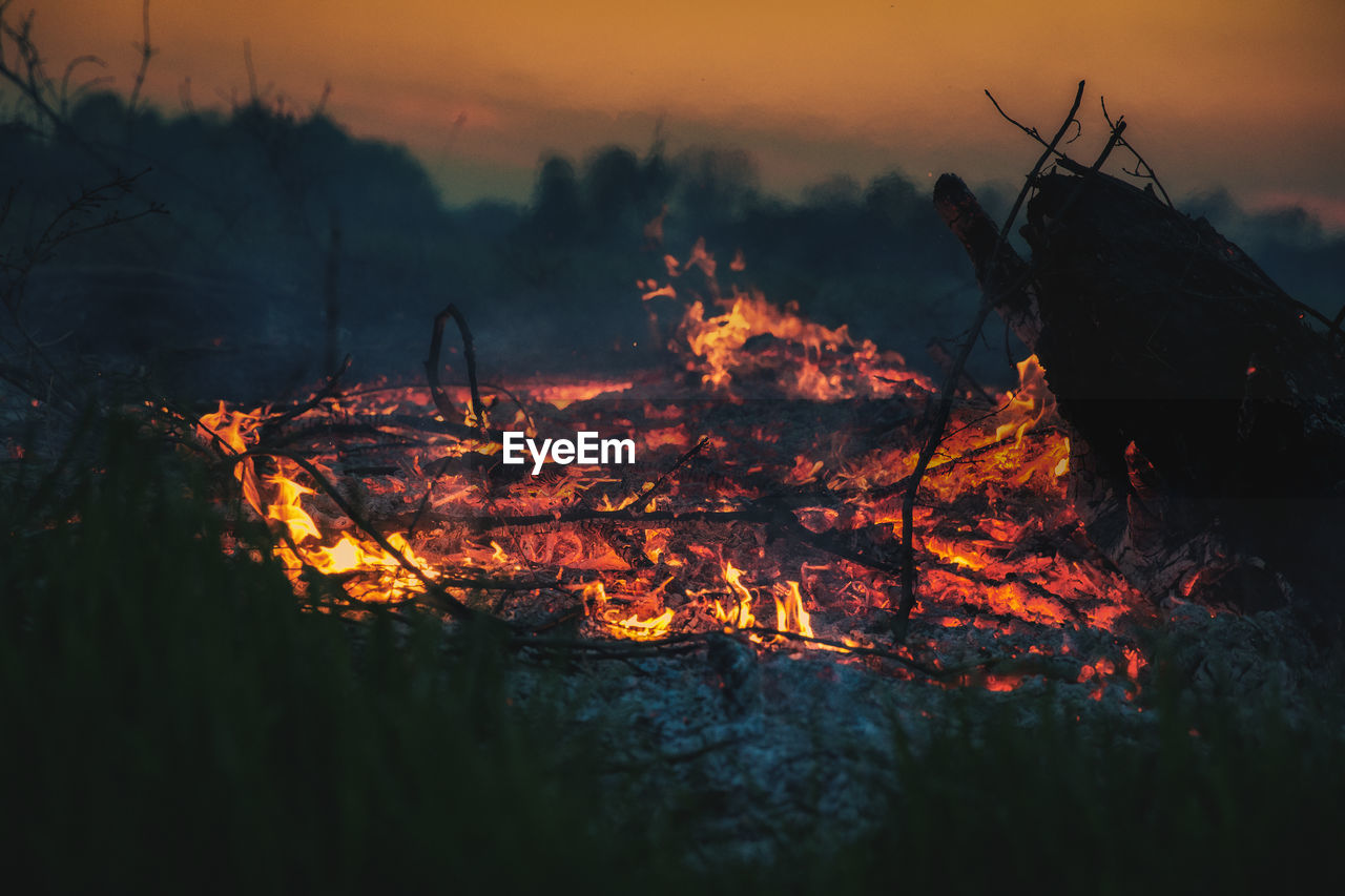 Bonfire On Field During Sunset