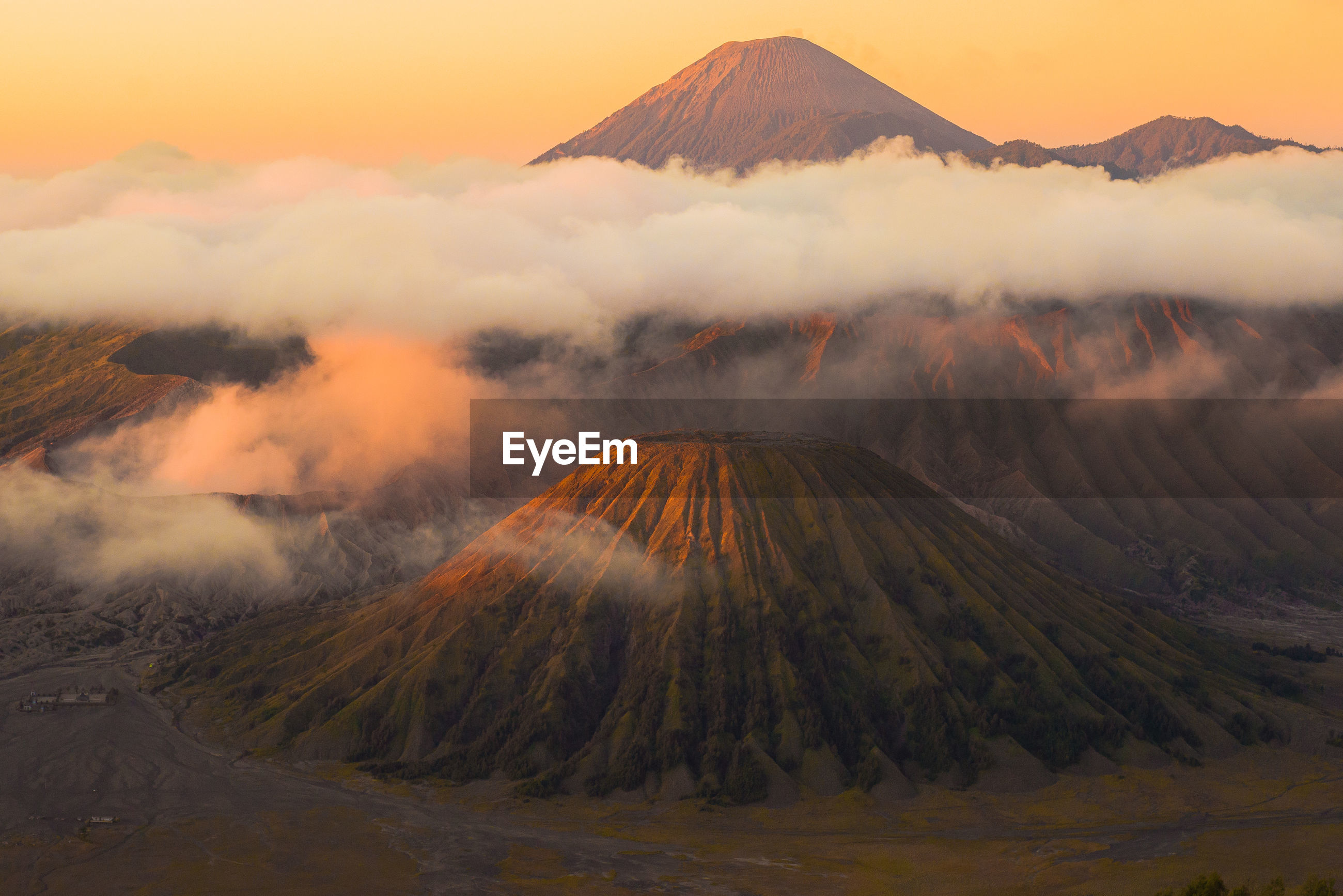 Scenic view of clouds over mt bromo during sunset