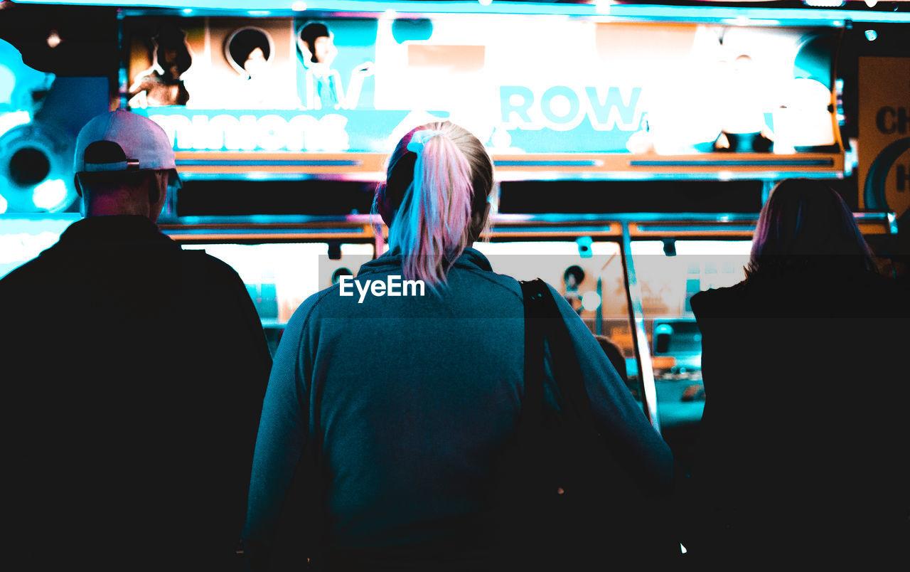 REAR VIEW OF PEOPLE ENJOYING AT BUS