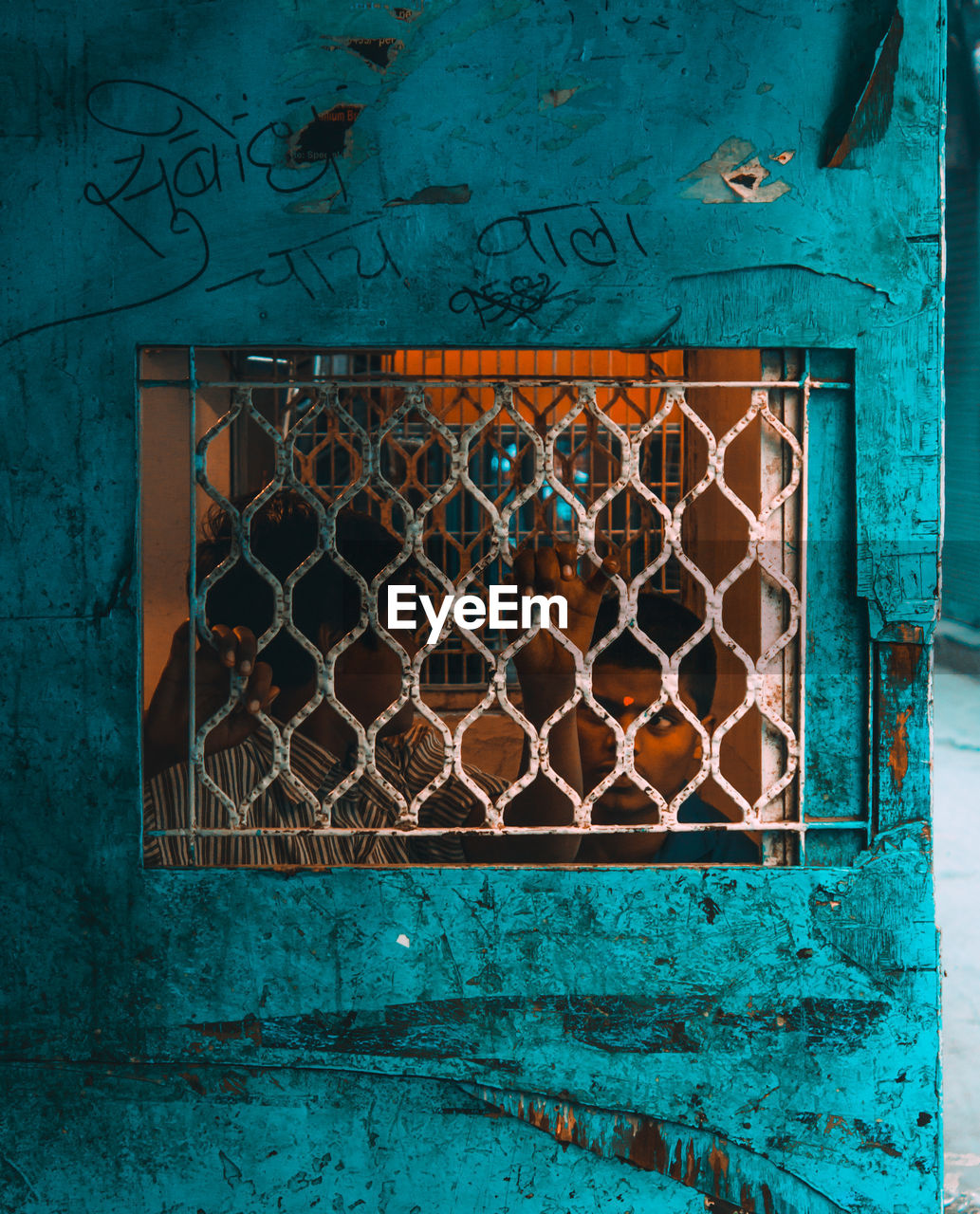 architecture, window, no people, built structure, building exterior, day, safety, metal, wall - building feature, outdoors, damaged, pattern, turquoise colored, security, close-up, old, weathered, blue, abandoned, protection