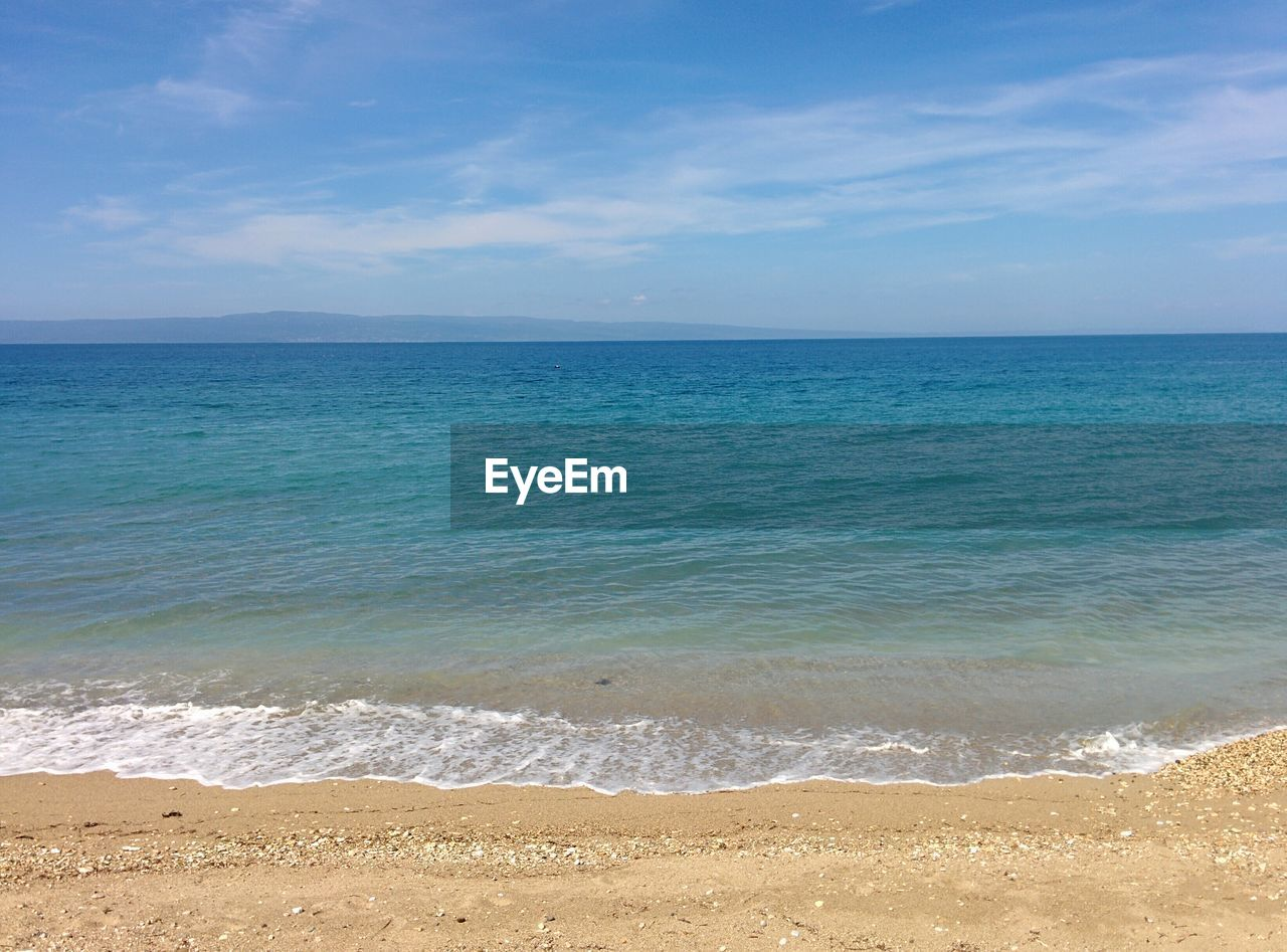 sea, beach, water, horizon over water, scenics, nature, beauty in nature, sand, sky, tranquil scene, tranquility, wave, blue, cloud - sky, outdoors, no people, day
