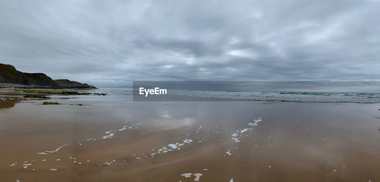 cloud - sky, water, sky, sea, beauty in nature, scenics - nature, land, beach, tranquility, nature, tranquil scene, day, no people, overcast, reflection, storm, horizon over water, outdoors