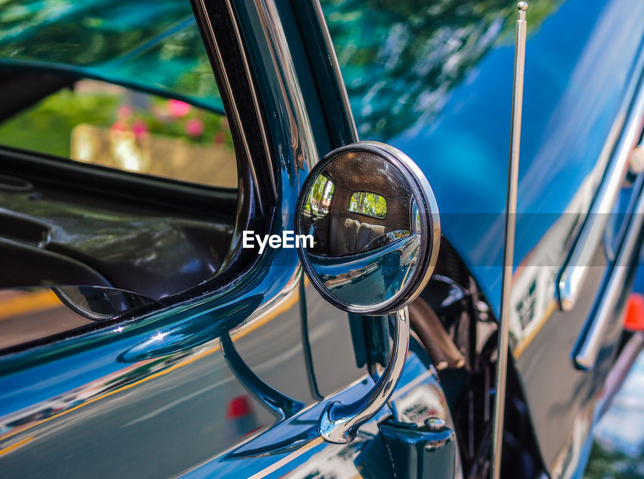 mode of transportation, land vehicle, transportation, car, reflection, motor vehicle, glass - material, side-view mirror, mirror, day, focus on foreground, close-up, outdoors, no people, headlight, transparent, retro styled, vehicle mirror, detail, vintage car, chrome
