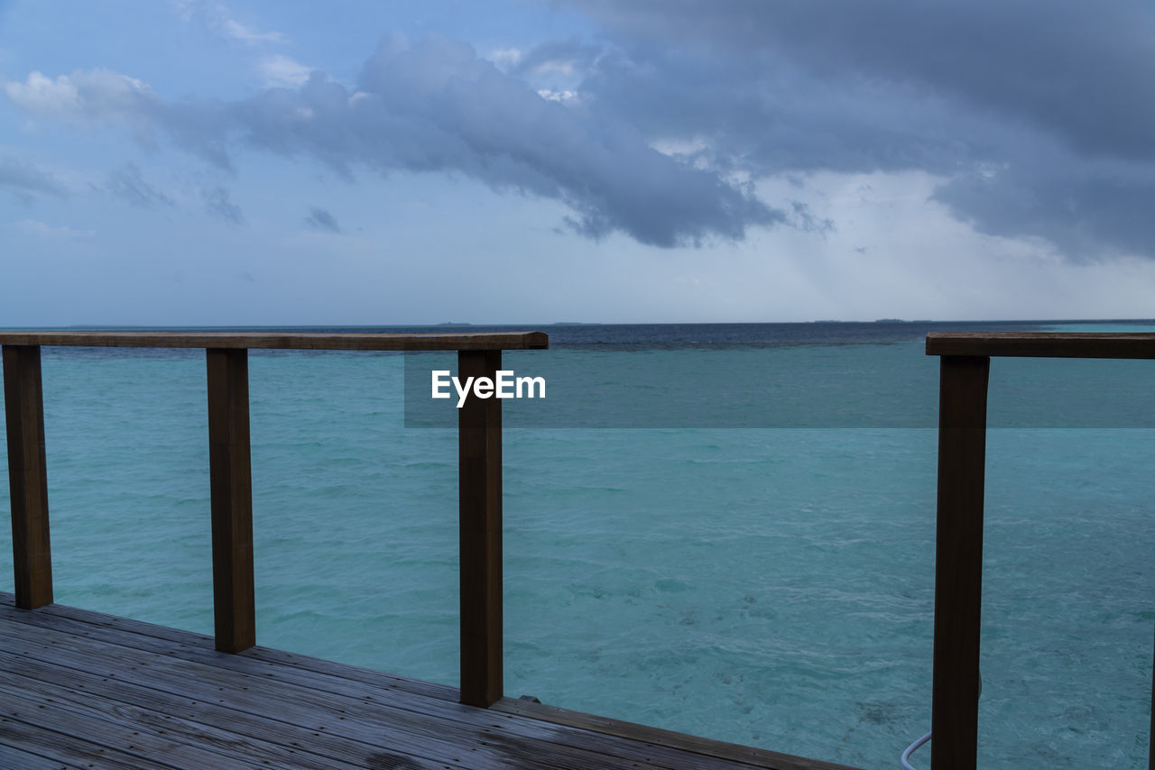 sea, water, sky, cloud - sky, scenics - nature, beauty in nature, horizon, nature, wood - material, day, tranquility, tranquil scene, horizon over water, railing, idyllic, architecture, pier, outdoors, non-urban scene, no people