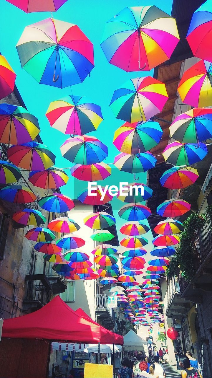multi colored, architecture, built structure, building exterior, outdoors, day, large group of people, city, people