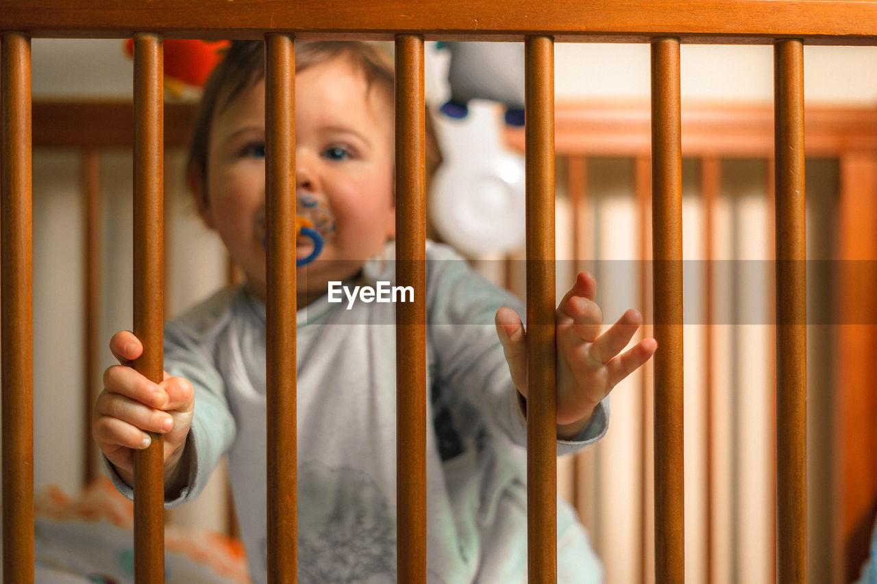 Cute Baby Boy In Crib
