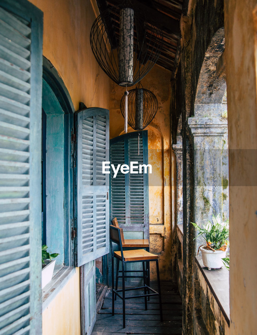 Empty Chairs In Porch