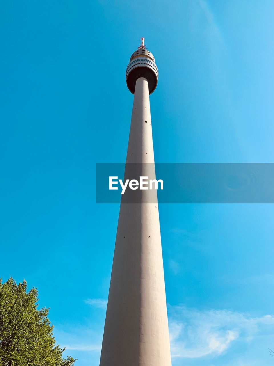low angle view, architecture, tower, built structure, blue, building exterior, tall - high, sky, nature, no people, day, communication, building, travel, outdoors, clear sky, guidance, sunlight, lighthouse, architectural column, spire, global communications