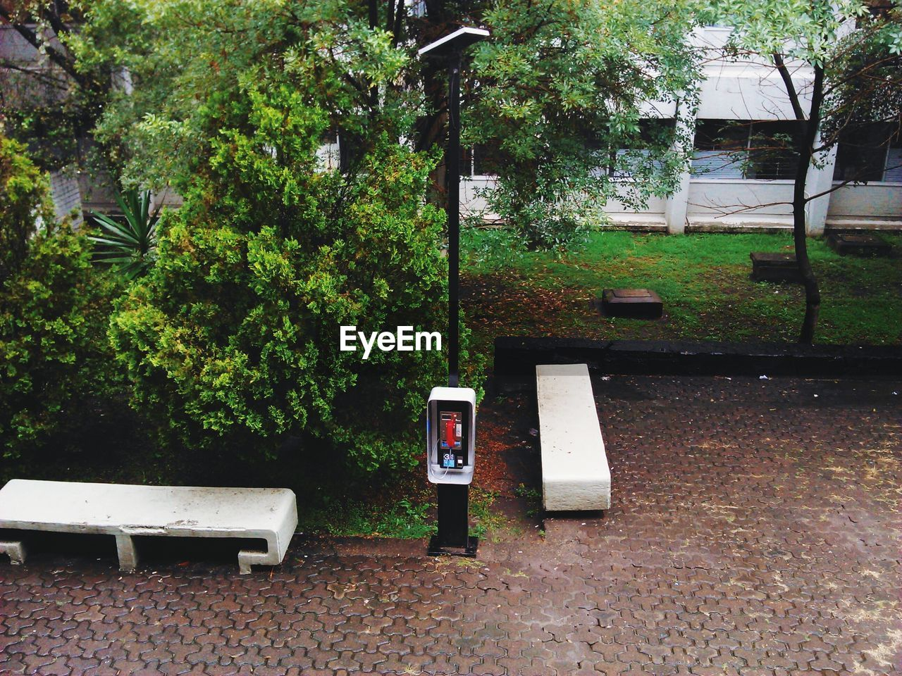 High Angle View Of Payphone Against Trees