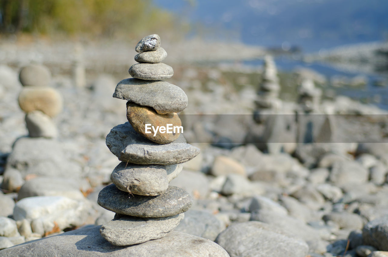 balance, solid, stack, stone - object, rock, pebble, stone, zen-like, rock - object, focus on foreground, nature, no people, day, beach, land, water, outdoors, sea, tranquility