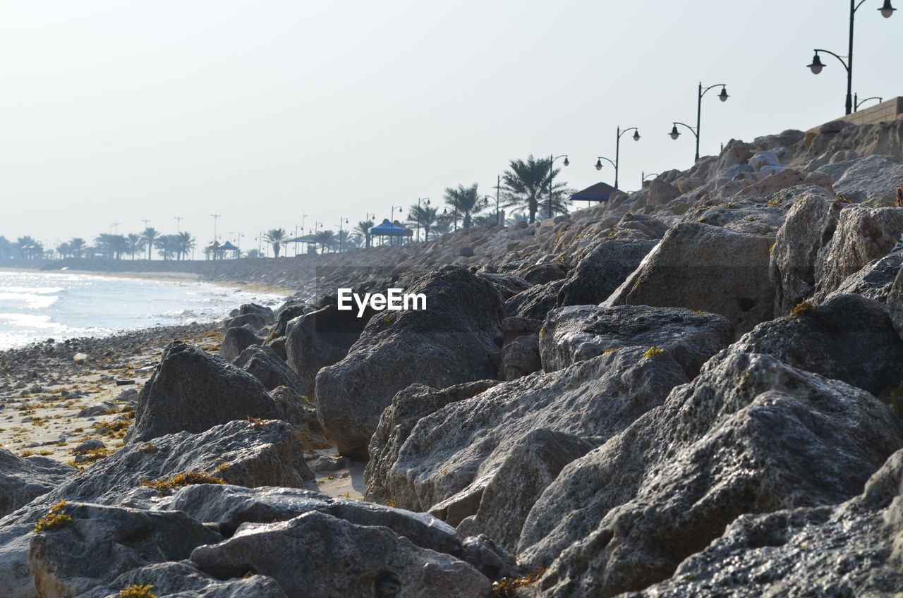 sea, rock - object, beach, clear sky, water, nature, no people, outdoors, day, sky, wave, beauty in nature