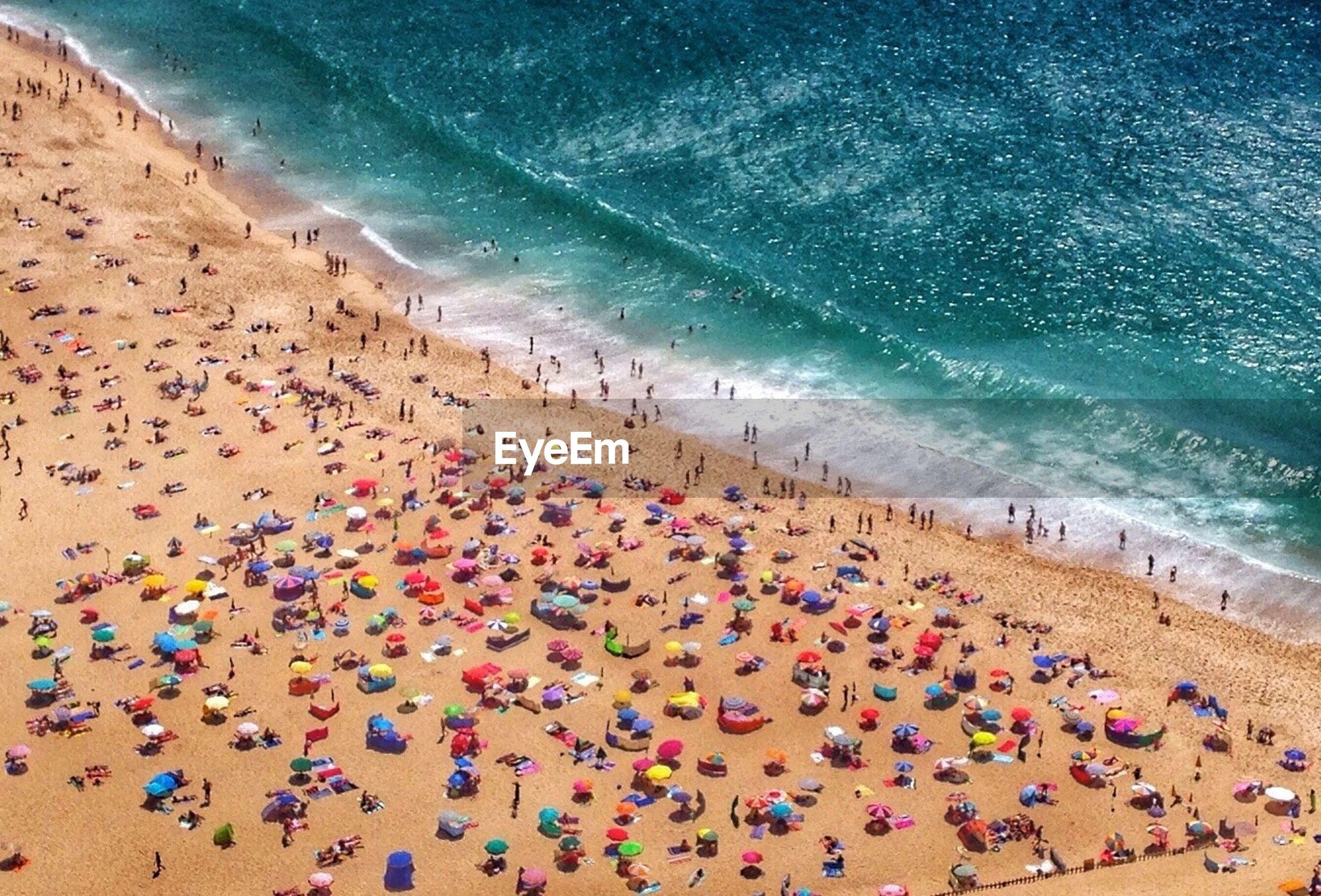 PEOPLE ENJOYING VACATION ON BEACH