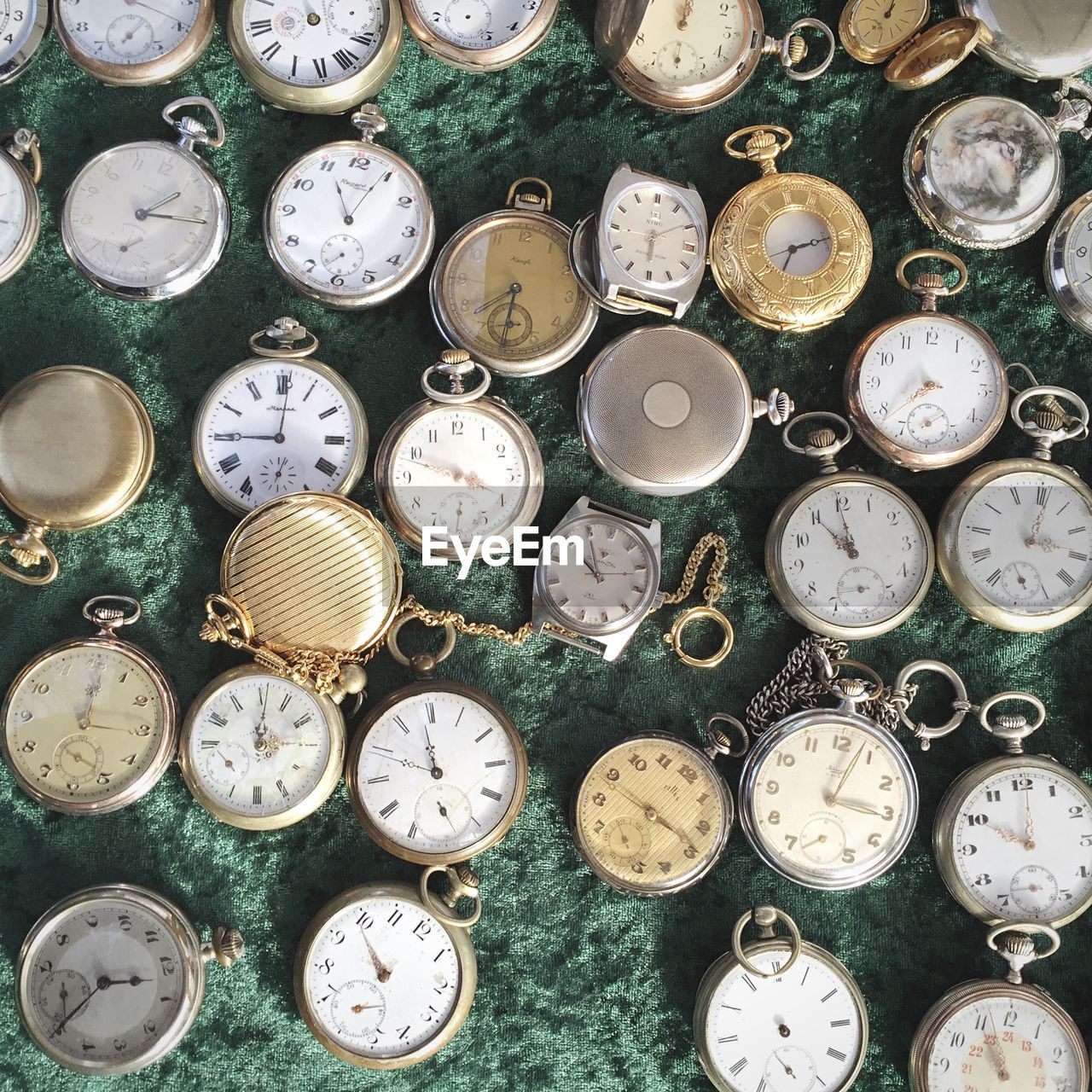 Directly above of old fashioned pocket watches in shop