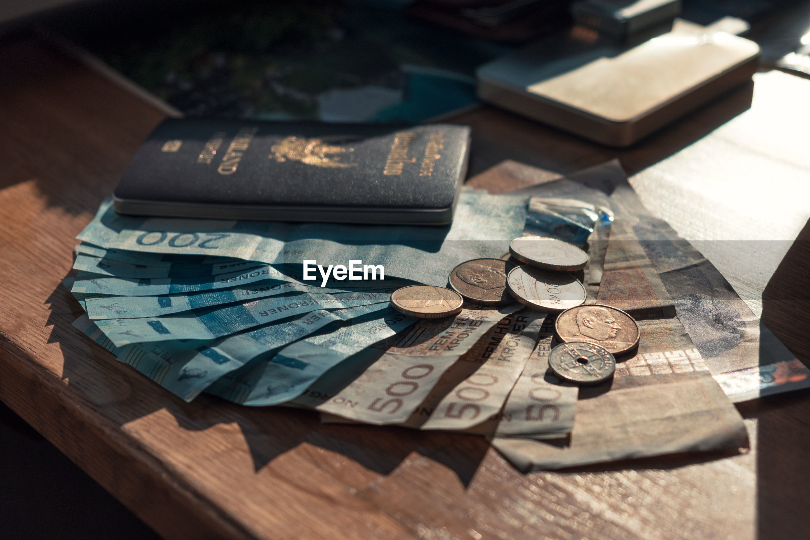 HIGH ANGLE VIEW OF COINS ON WOODEN TABLE