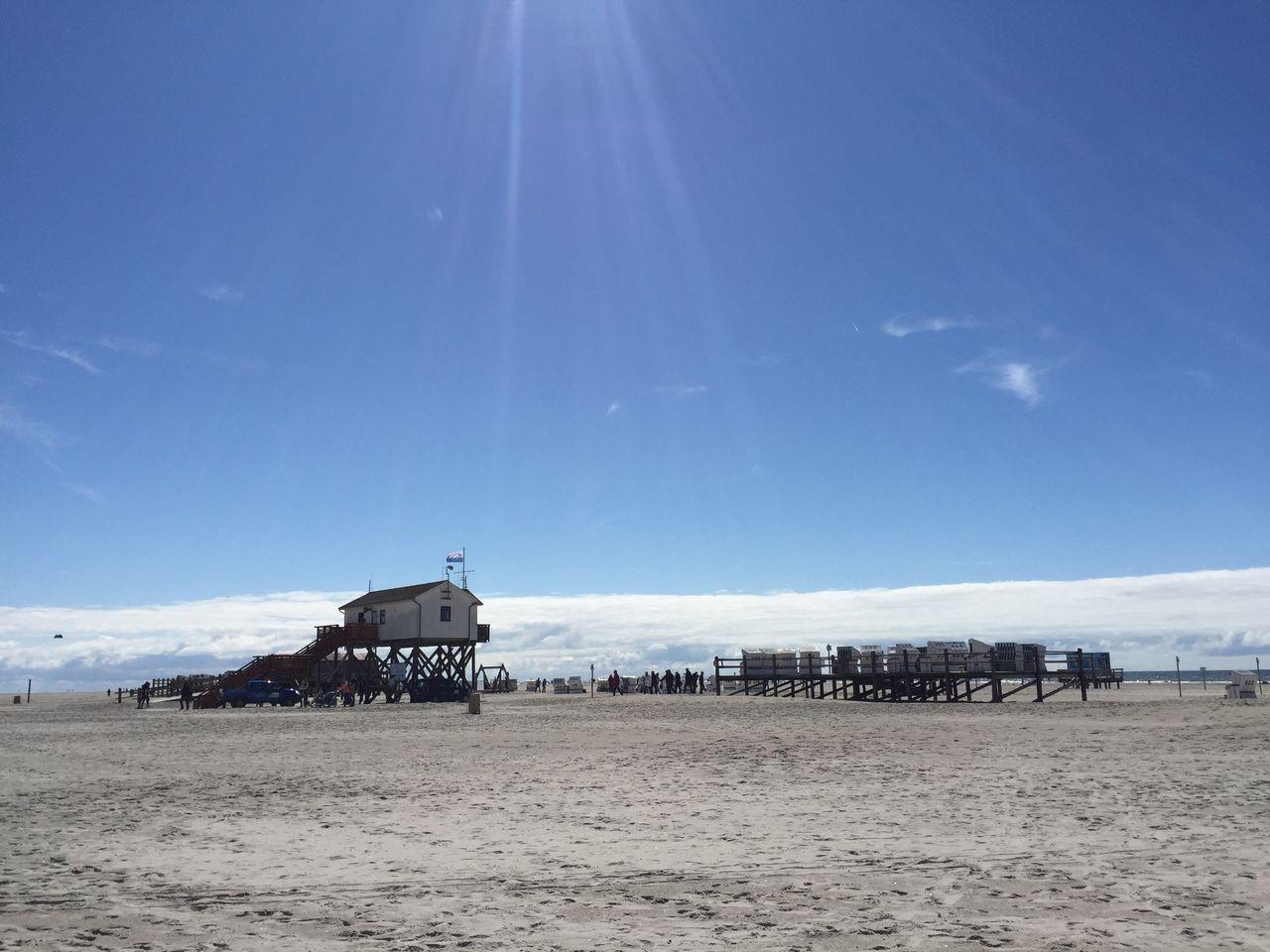 Piers On Beach Against Sky