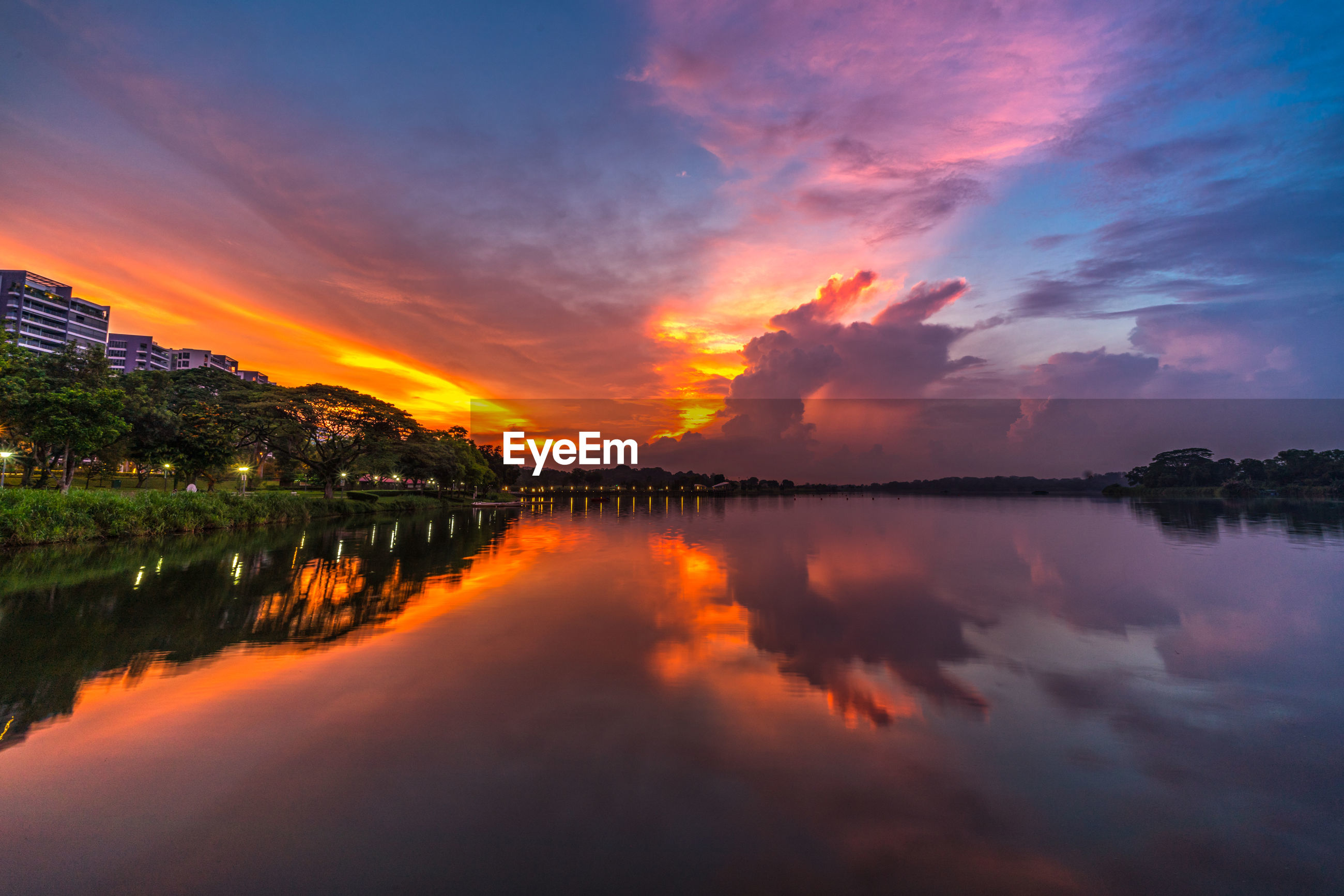 SCENIC VIEW OF LAKE AGAINST ORANGE SKY