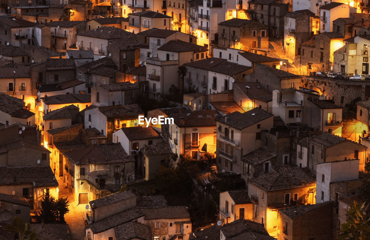 High angle view of illuminated buildings in town
