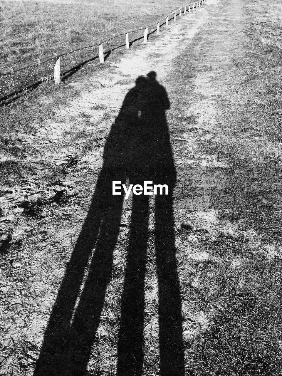 Shadow Of Boys On Field