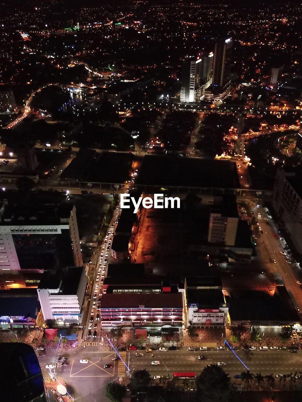 AERIAL VIEW OF ILLUMINATED CITY