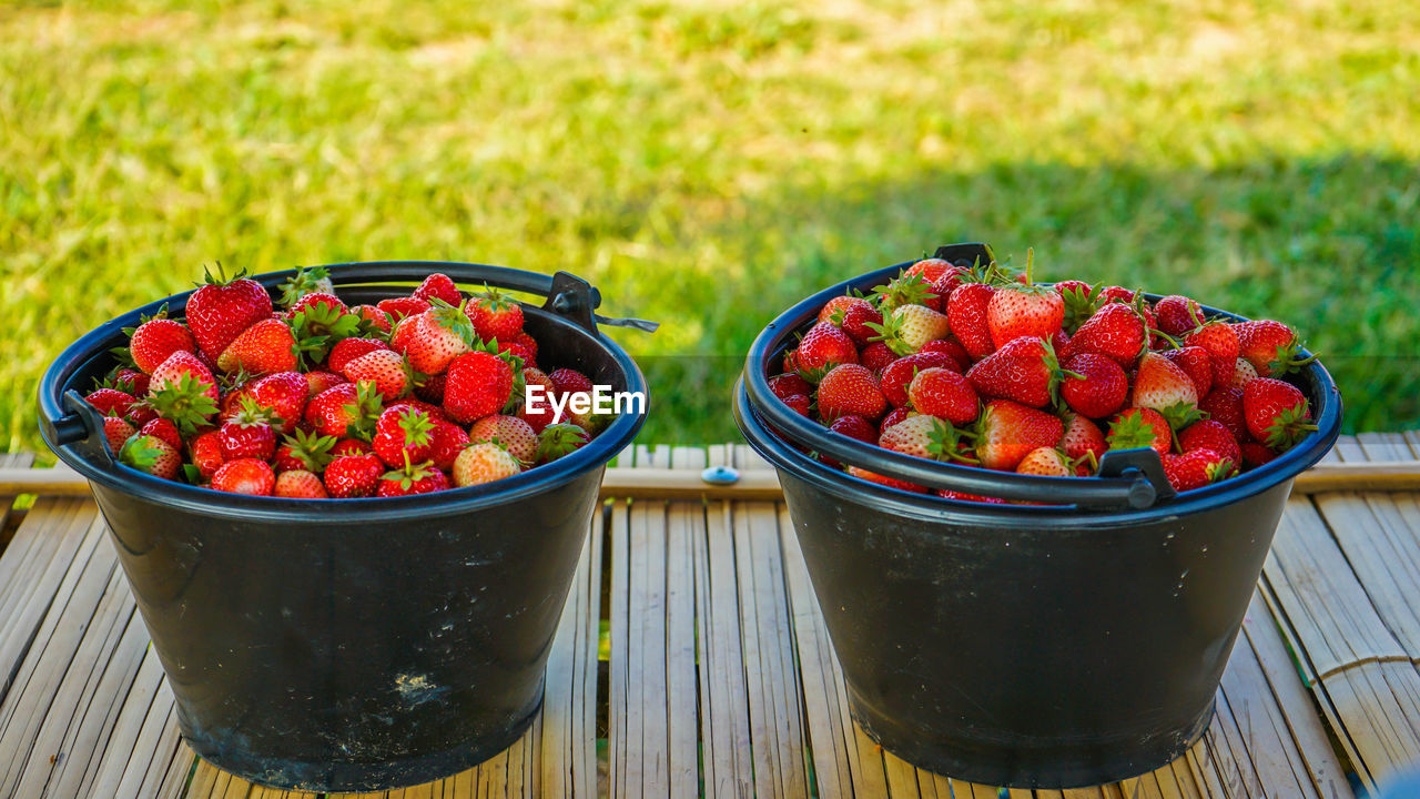 Close-up of strawberries in containers on table